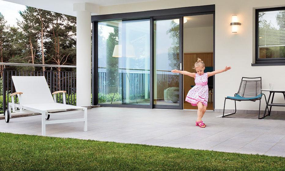 Sliding patio door / in wood / aluminum / double-glazed